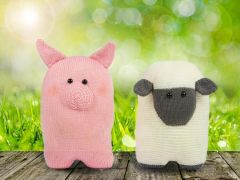 Knitted Sheep and Pig Cushions by Amanda Berry in Deramores Studio DK